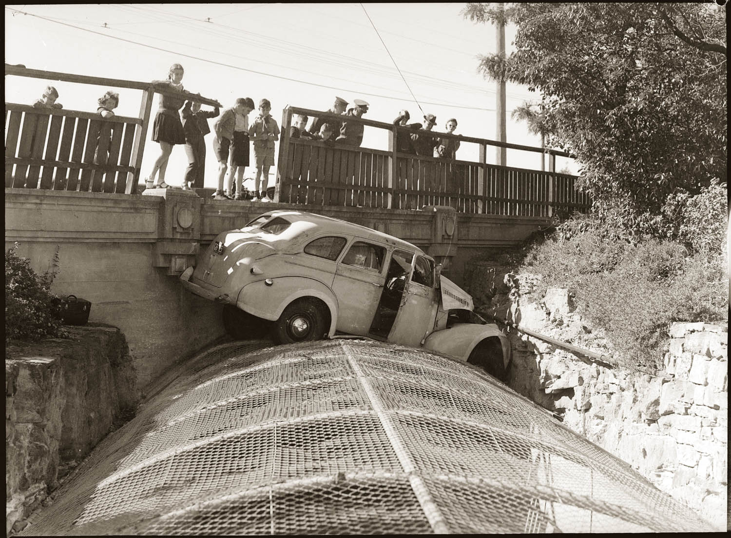 Car crash from bridge onto wire canal cover, early 1940s. details unknown.