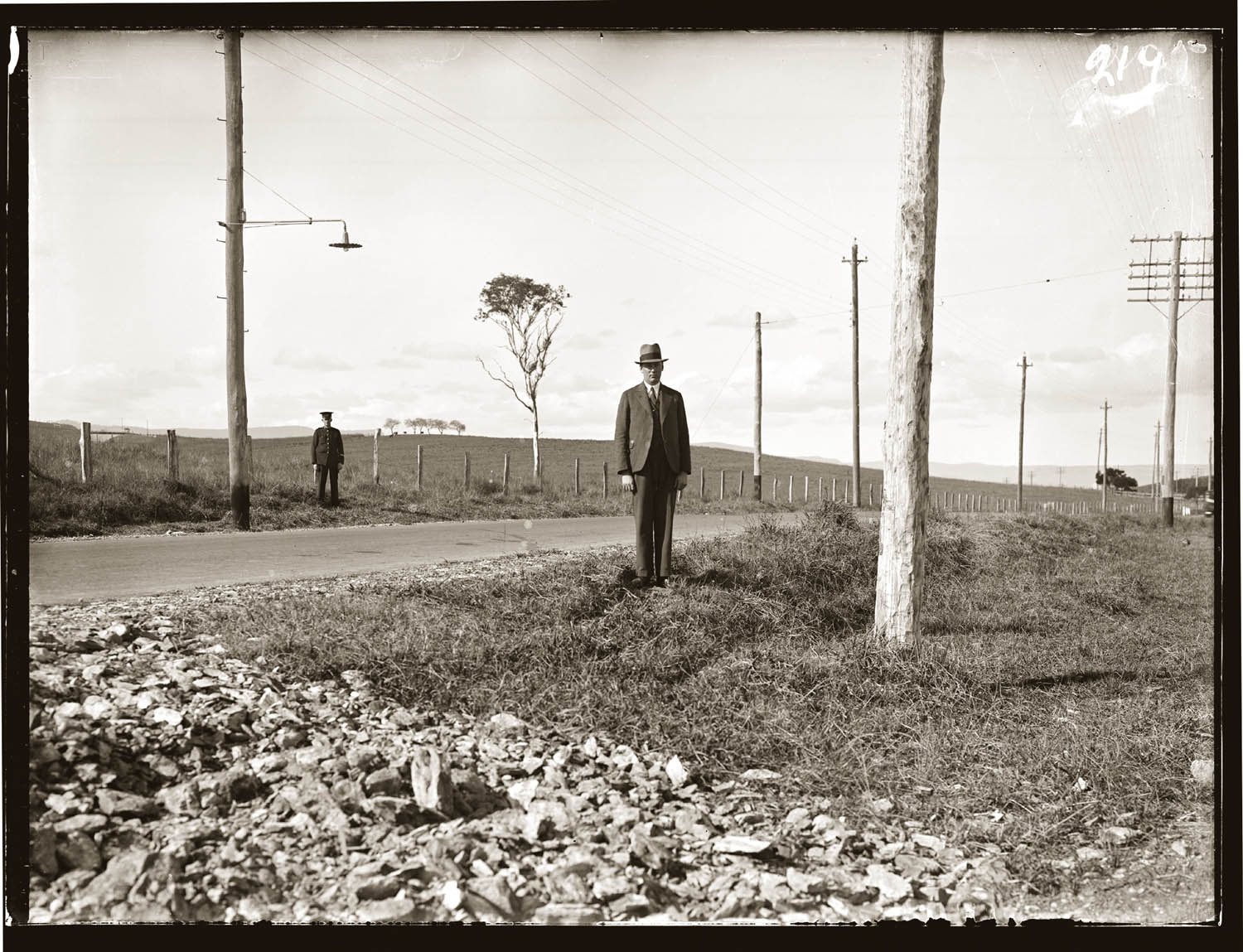 Telegraph poles & detectives 1920s. Date and place unknown.