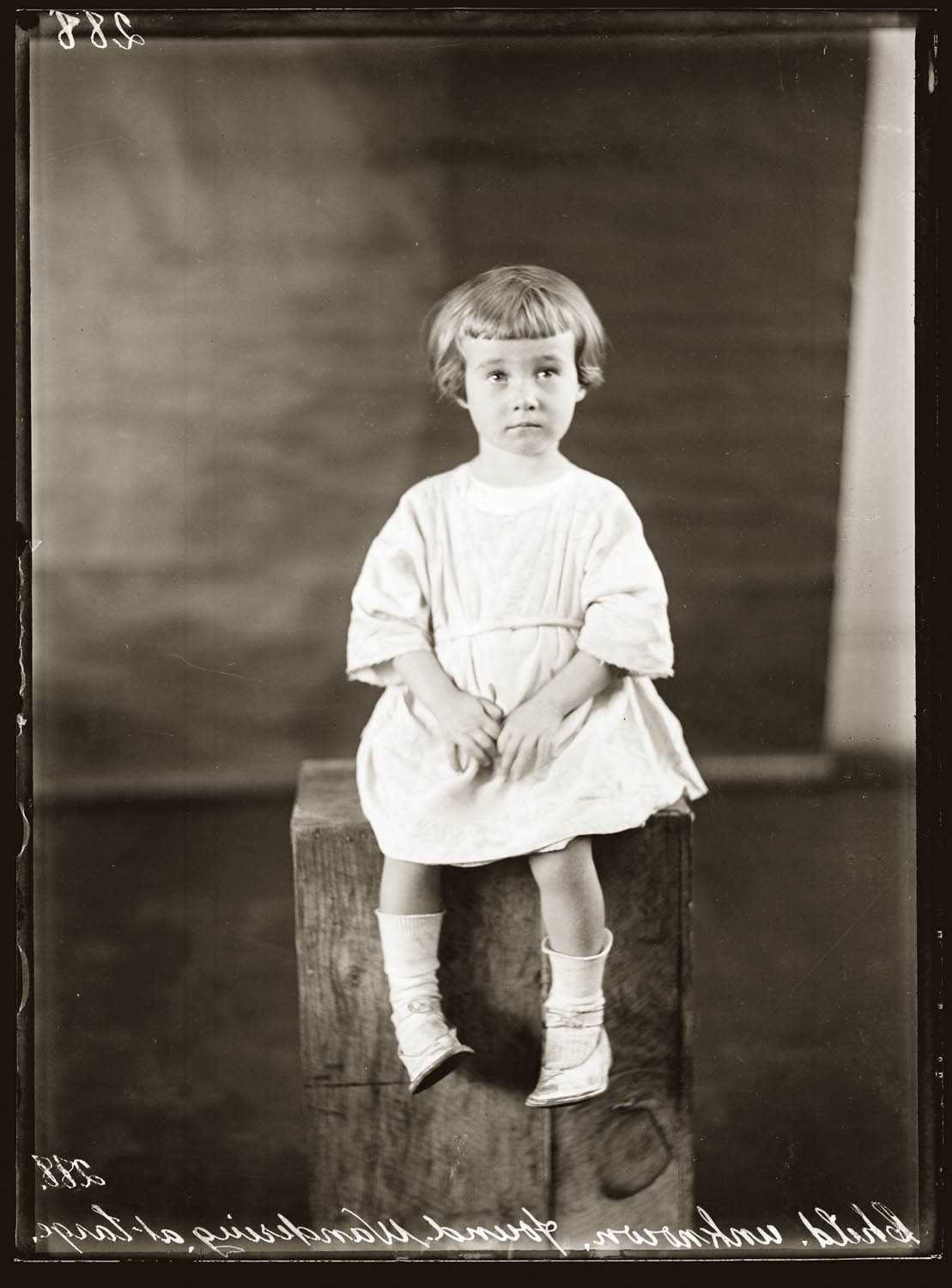 "Mid 1920s. Inscribed ""Child unknown found wandering at large"". Details unknown."