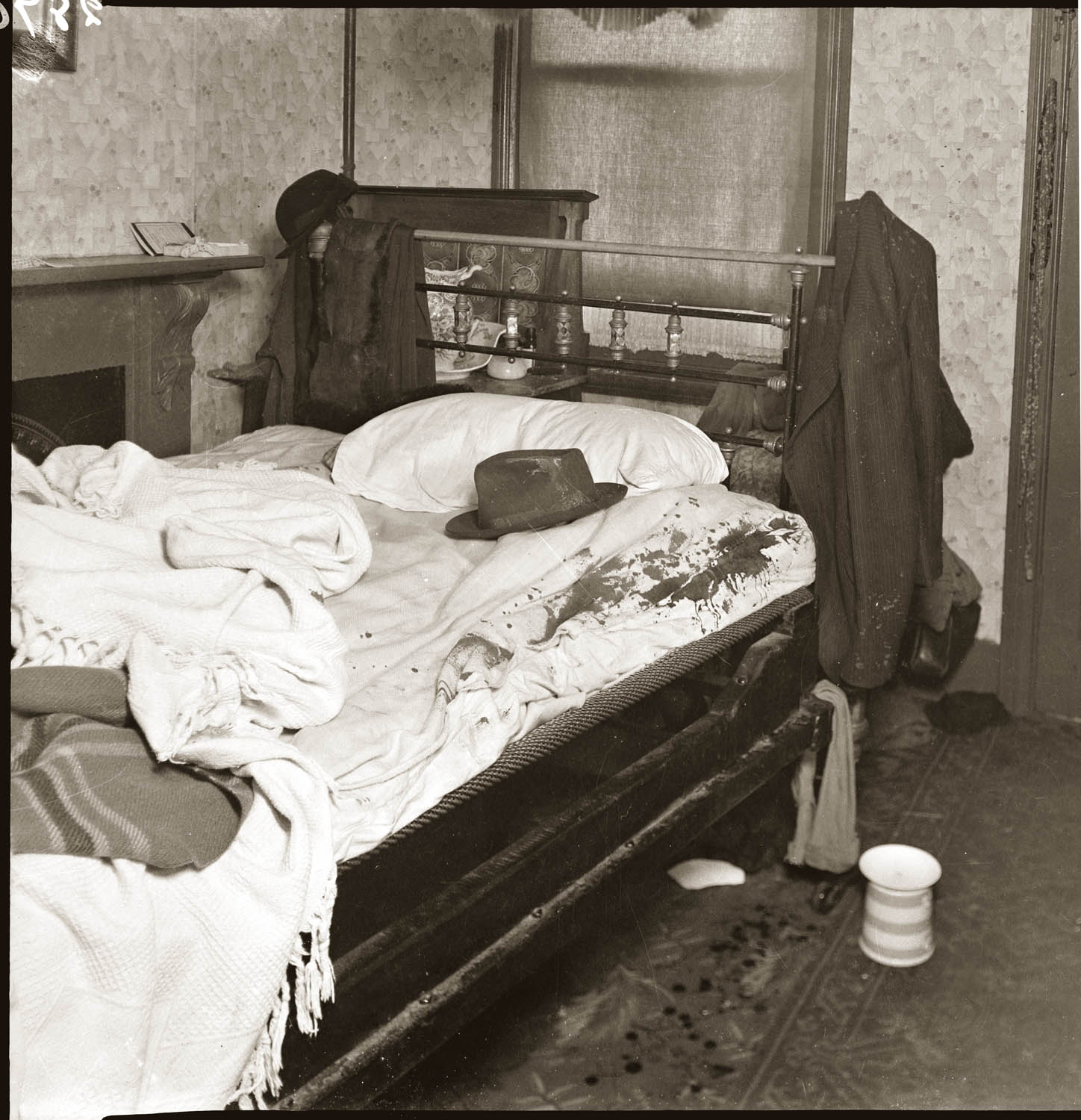 Domestic interior: bloodstains on bed sheets and man's hat. Probably mid 1940s, details unknown.