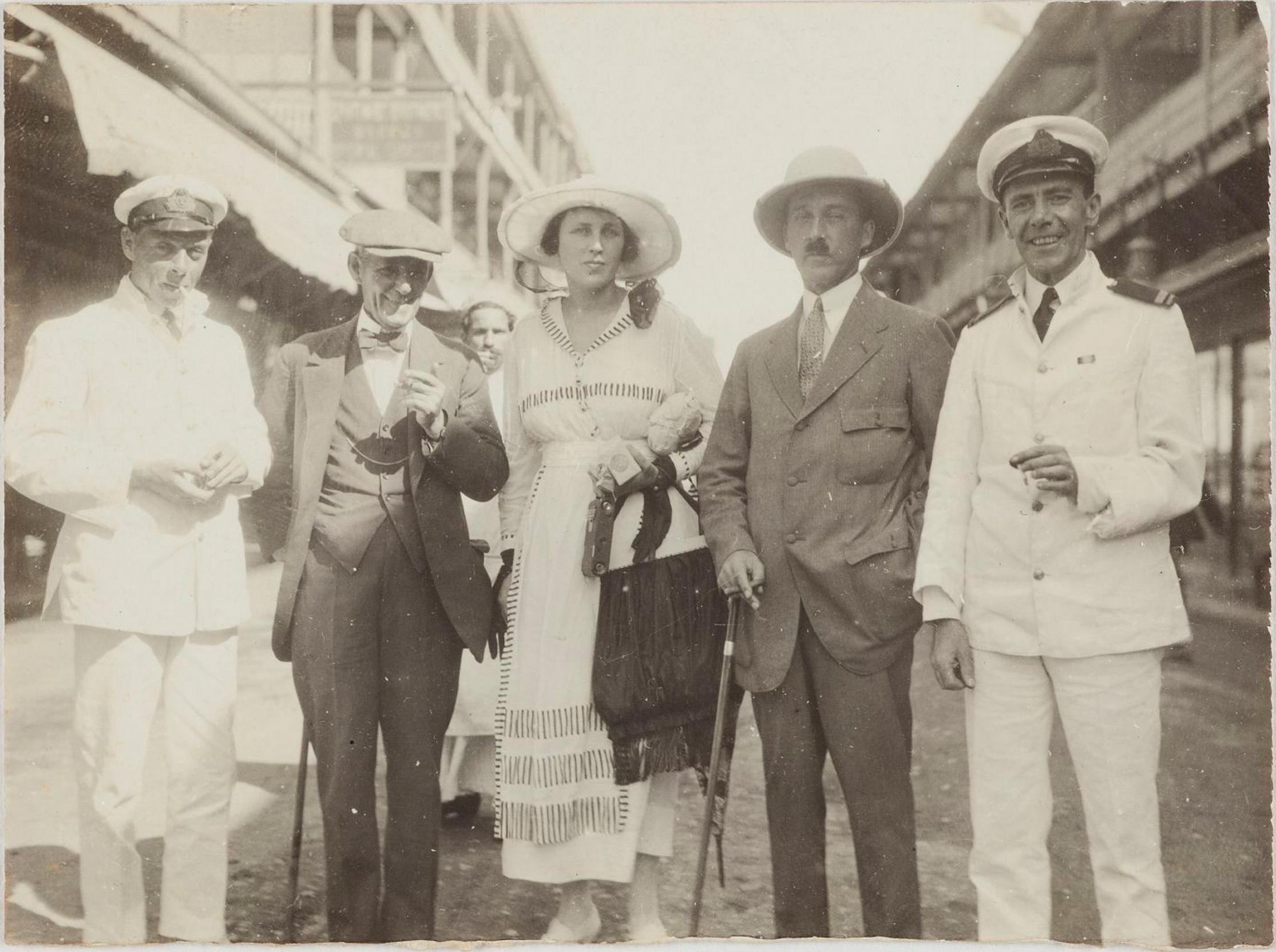 Port Said, Egypt, 18 April 1919: Dora and Leslie Walford with officers from RMS Osterley. Ephtimios Brothers Stores, 'Oriental curiosities' in the background / photographer unknown